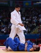 Georgia's Lasha Shavdatuashvili celebrates after winning against Japan's Masashi Ebinuma during their men's 66kg contest semifinal match of the judo...