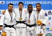 Georgia's Lasha Shavdatuashvili celebrates his gold medal on the podium with silver medalist Russia's Kamal KhanMagomedov and bronze medalists...