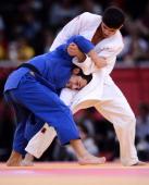 Georgia's Lasha Shavdatuashvili competes with Chile's Alejandro Zuniga during their men's 66kg contest match of the judo event at the London 2012...