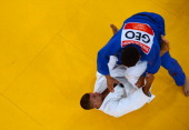 Georgia's Lasha Shavdatuashvili competes with Hungary's Miklos Ungvari during their men's 66kg contest final match of the judo event at the London...