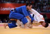 Georgia's Lasha Shavdatuashvili competes with Japan's Masashi Ebinuma during their men's 66kg contest semifinal match of the judo event at the London...
