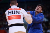 Georgia's Lasha Shavdatuashvili compets with Hungary's Miklos Ungvari during their men's 66kg contest final match of the judo event at the London...