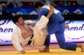 Georgia's Lasha Shavdatuashvili fights with United Arab Emirates' Victor Scvortov during the final of the men 73kg category of the Judo Grand Prix in...