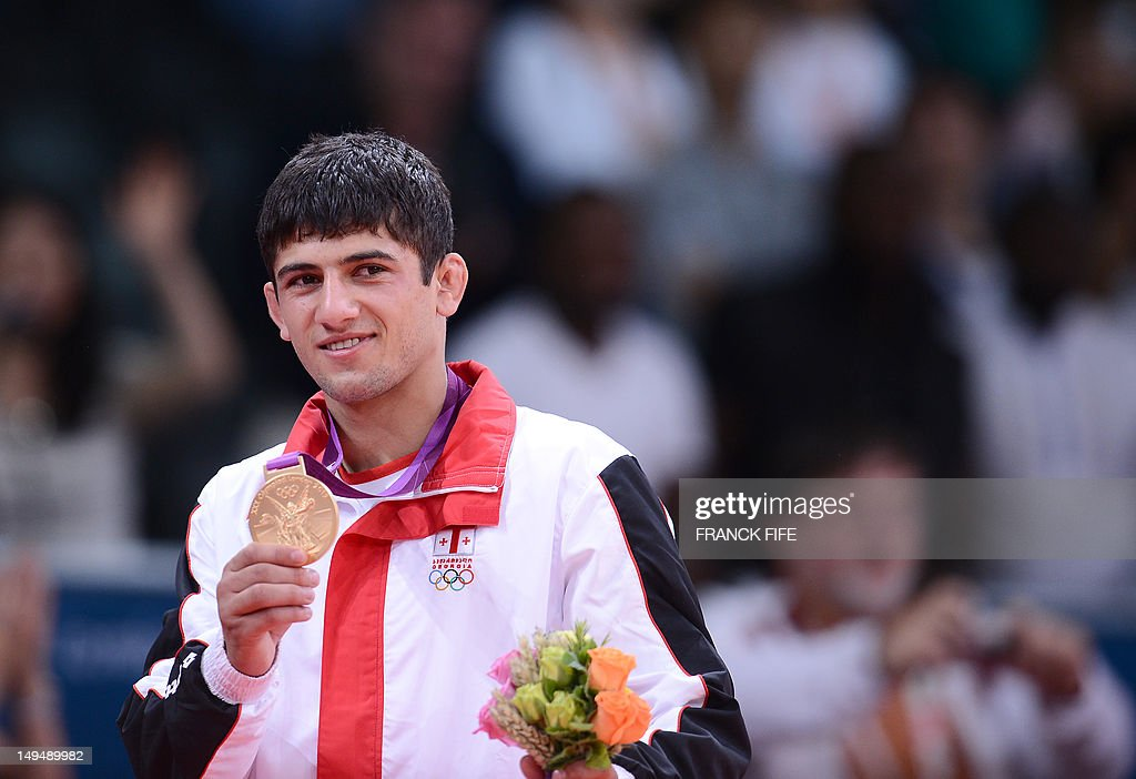 Georgia's Lasha Shavdatuashvili poses with his gold medal after the podium ceremony of the men's 66kg contest of the judo event at the London 2012...