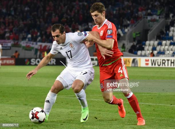 Georgia's midfielder Giorgi Merebashvili and Wales' defender Ben Davies vie for the ball during the FIFA World Cup 2018 qualification football match...