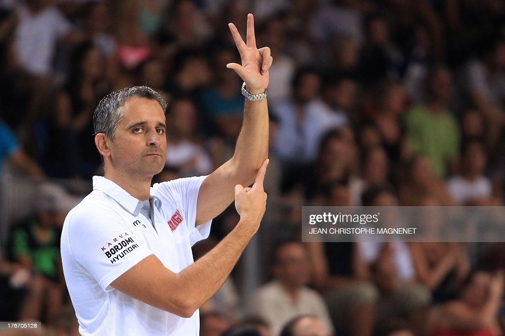 Georgia's national basketball team head coach Igor Kokoskov gives instructions to his players during the friendly basketball match France-Georgia, on August 17, 2013 in Antibes, southeastern France, as part of the preparation for the 2013 EuroBasket in Slovenia. AFP PHOTO / JEAN CHRISTOPHE MAGNENET