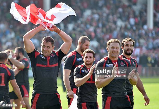 Georgia's players celebrate after winning a Pool C match of the 2015 Rugby World Cup between Tonga and Georgia at Kingsholm stadium in Gloucester...