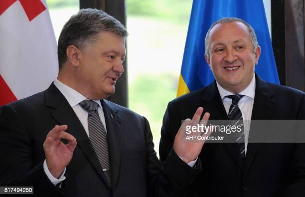 Georgia's President Giorgi Margvelashvili poses with his Ukrainian counterpart Petro Poroshenko during a signing ceremony in Tbilisi on July 18 2017...