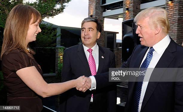 Georgia's President Mikhail Saakashvili looks on as his Dutchborn wife Sandra Roeloefs shakes hands with US property mogul Donald Trump as they meet...