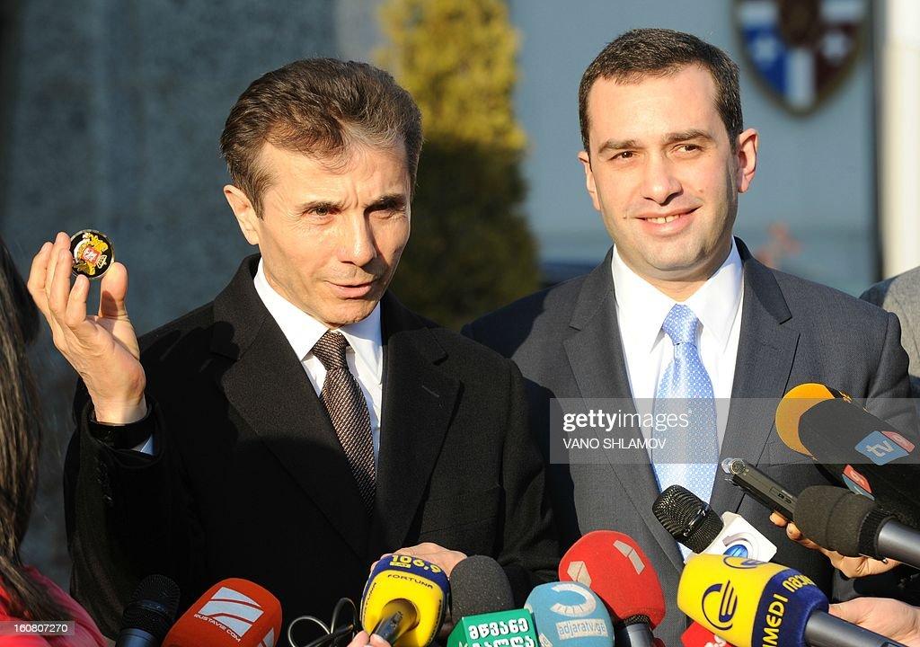 Georgia's Prime Minister Bidzina Ivanishvili (L) and Defence Minister Irakli Alasania speaks to the media after Ivanishvili's visit to Defence Ministry in Tbilisi, on February 6, 2013.