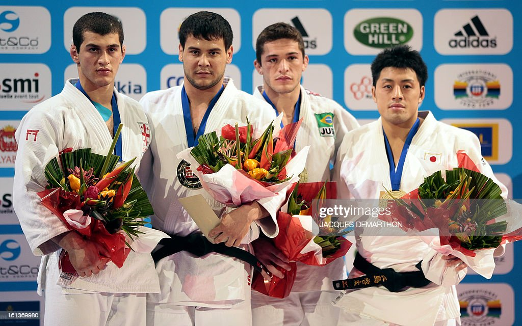 Georgia's silver medalist Avtandil Tchrikishvili, Uzbekistan's gold medalist Yakhyo Imamov, and bronze medalists Brazil's Victor Penalber and Japan's Nagashima Keita, pose on the podium of the Men -81kg contest of the Paris' Judo Grand Slam tournament on february 10, 2013 in Paris.