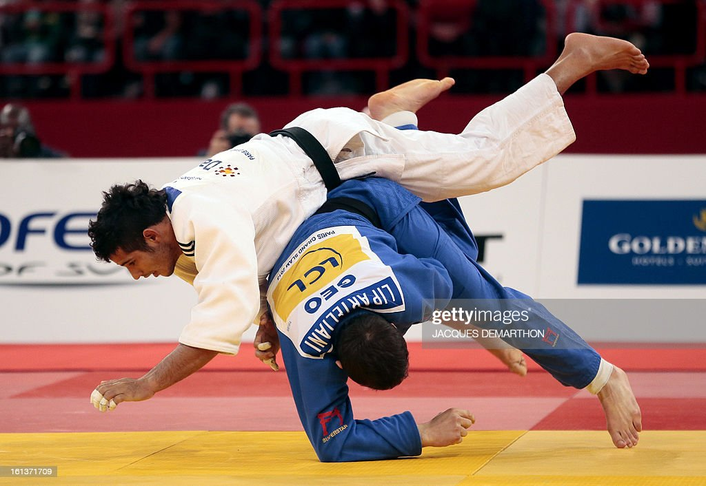 Georgia's Varlam Liparteliani (blue) competes with Cuba's Asley Gonzalez (white) during the final of the Men's -90kg category of the Paris Judo Grand Slam tournament, at the Palais Omnisports de Paris-Bercy (POPB) in Paris, on February 10, 2013. AFP PHOTO/JACQUES DEMARTHON