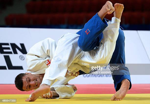 Georgias Varlam Liparteliani competes with Georgias Beka Gviniashvili during the mens bronze medal match in the 90kg category at the Judo World...