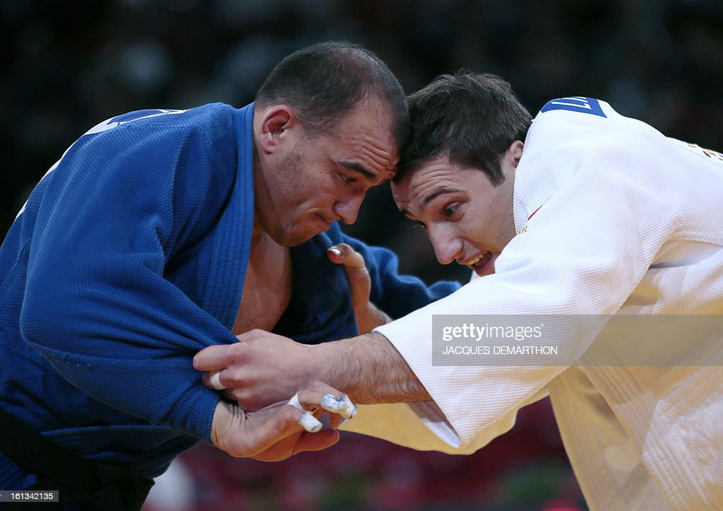 Georgia's Varlam Liparteliani (white) fights against Uzbekistan's Dilshod Choriev (blue) on February 10, 2013 in Paris, during the semi-finals of the Men -90kg of the Paris Judo Grand Slam tournament. AFP PHOTO/JACQUES DEMARTHON