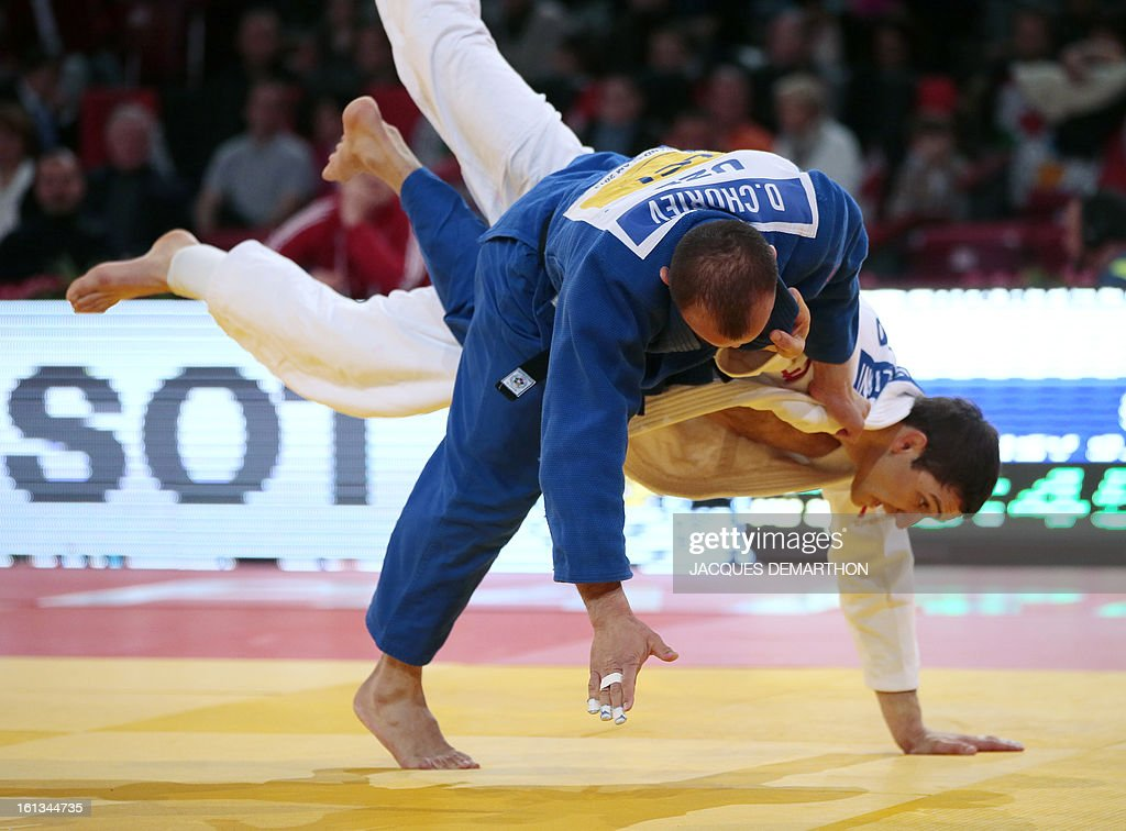 Georgia's Varlam Liparteliani (white) fights against Uzbekistan's Dilshod Choriev on February 10, 2013, during the Men -90kg semi-finals of the Paris International Judo tournament, part of the Grand Slam, at the Palais Omnisports de Paris-Bercy (POPB) in Paris.