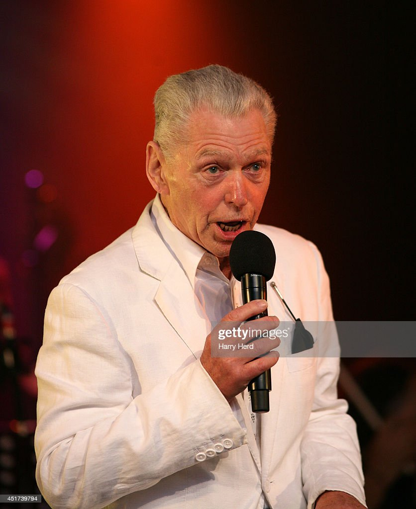 <a gi-track='captionPersonalityLinkClicked' href=/galleries/search?phrase=Georgie+Fame&family=editorial&specificpeople=1582325 ng-click='$event.stopPropagation()'>Georgie Fame</a> performs on stage at Cornbury Music Festival at Great Tew Estate on July 5, 2014 in Oxford, United Kingdom.