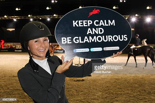 Georgina Bloomberg holds a sign during the Longines Los Angeles Masters at Los Angeles Convention Center on September 27 2014 in Los Angeles...