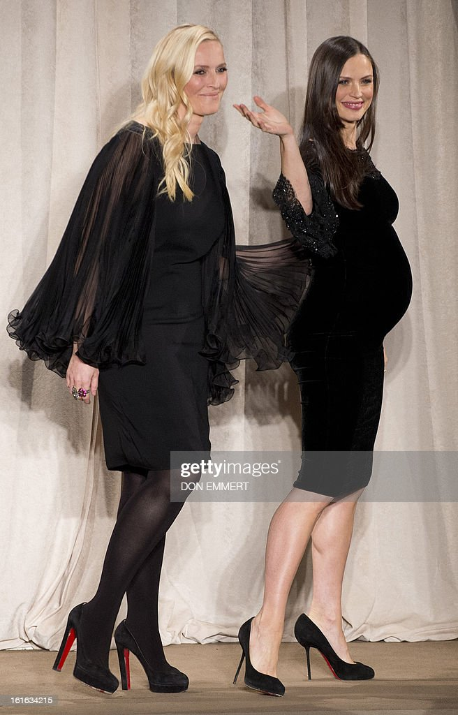 Georgina Chapman (R) and Keren Craig, designers from Marchesa, waves to the audience after their show at the Mercedes-Benz fashion week February 13, 2013 in New York.