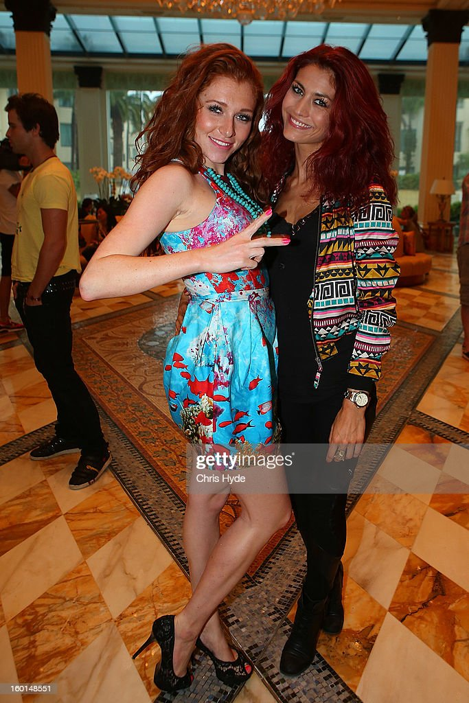 Georgina Fleur and Fiona Erdmann pose after arriving at the Versace hotel after spending two weeks in the Australian Outback on January 27, 2013 in Gold Coast, Australia. The German celebrities are participants in the 2013- RTL-TV-Show 'Dschungelcamp' - Ich bin ein Star - Holt mich hier raus!.
