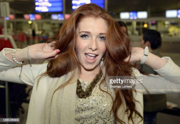 Georgina Fleur pose at the Frankfurt airport before the flight to Australia on January 6 2013 in Frankfurt am Main Germany They are participants of...