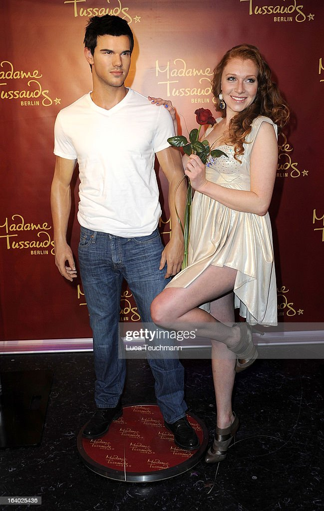 Georgina Fleur poses with the Taylor Lautner wax figure as it is unveiled at Madame Tussauds Berlin on March 19, 2013 in Berlin, Germany.