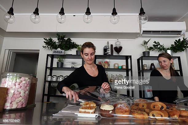 Georgina HewittBigggs and Sara TianiFantino of Cigana Cafe in St Heliers work without the lights on offering only pastries on October 06 2014 in...