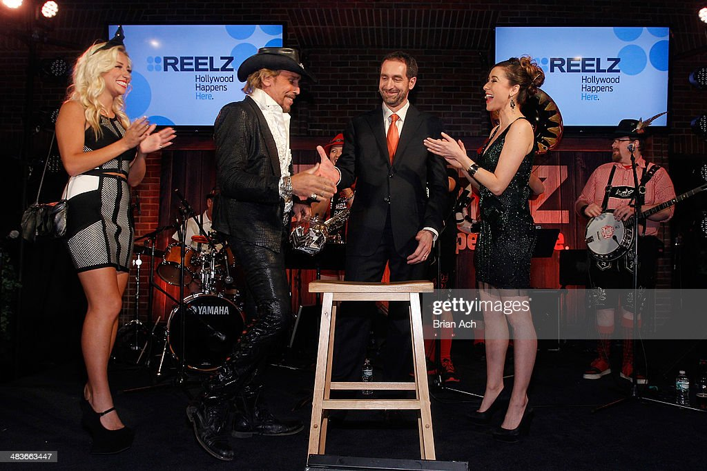 Georgina Leahy and Richie Marcello of Treasure King, Senior Vice President of Advertising Sales at Reelz Bill Rosolie, and TV personality Julie Alexandria appear onstage at the REELZ Channel upfront presentation at Hudson Hotel on April 9, 2014 in New York City.