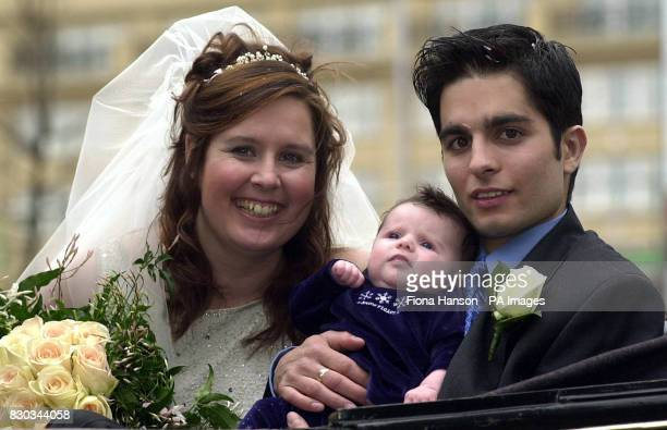 Georgina Lewis and John O'Farrell with 8 week old daughter Alexandra on their way to Southwark Register Office London Georgina proposed to her...