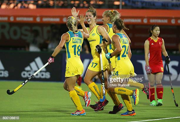 Georgina Morgan of Australia celebrates with team mates as she scores their first goal from a penalty corner during the Pool B match between...