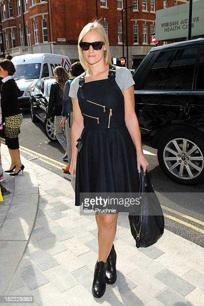 Georgina poses wearing an Anouska dress and Blue Velvet shoes at the Erdem catwalk presentation during London Fashion Week S/S 2013 on September 17...