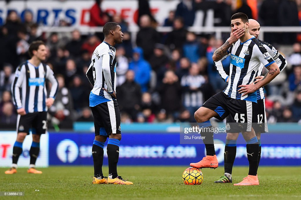 <a gi-track='captionPersonalityLinkClicked' href=/galleries/search?phrase=Georginio+Wijnaldum&family=editorial&specificpeople=2146603 ng-click='$event.stopPropagation()'>Georginio Wijnaldum</a> (2nd L), Aleksandar Mitrovic (2nd R) and <a gi-track='captionPersonalityLinkClicked' href=/galleries/search?phrase=Jonjo+Shelvey&family=editorial&specificpeople=4940315 ng-click='$event.stopPropagation()'>Jonjo Shelvey</a> (1st R) of Newcastle United react after Bournemouth's second goal during the Barclays Premier League match between Newcastle United and A.F.C. Bournemouth at St James' Park on March 5, 2016 in Newcastle upon Tyne, England.