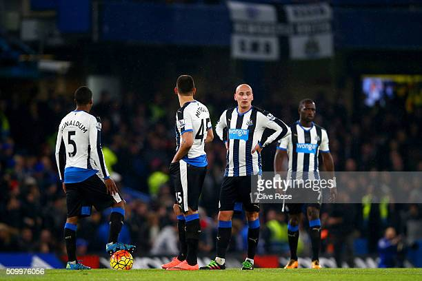 Georginio Wijnaldum Aleksandar Mitrovic Jonjo Shelvey and Moussa Sissoko of Newcastle United react after Chelsea's second goal during the Barclays...