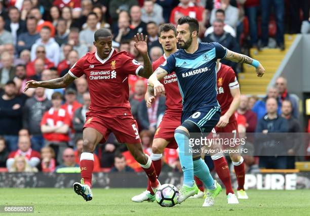 Georginio Wijnaldum and Dejan Lovren of Liverpool and Alvaro Negredo of Middlesbrough in action during the Premier League match between Liverpool and...