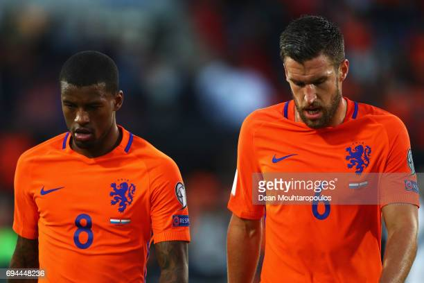 Georginio Wijnaldum and Kevin Strootman of the Netherlands walk off the ground at half time during the FIFA 2018 World Cup Qualifier between the...