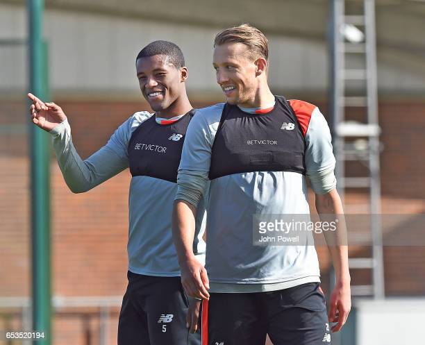 Georginio Wijnaldum and Lucas Leiva of Liverpool during a training session at Melwood Training Ground on March 15 2017 in Liverpool England