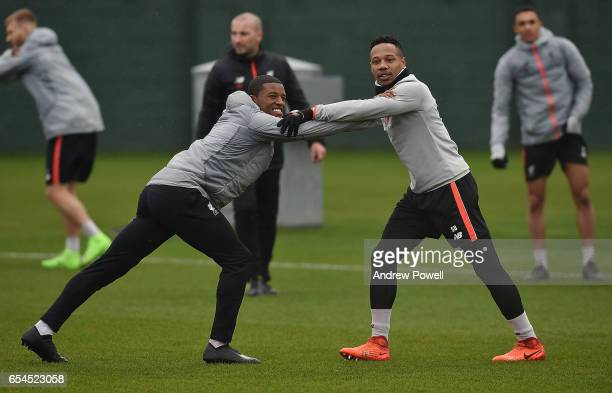 Georginio Wijnaldum and Nathaniel Clyne of Liverpool during a training session at Melwood Training Ground on March 17 2017 in Liverpool England