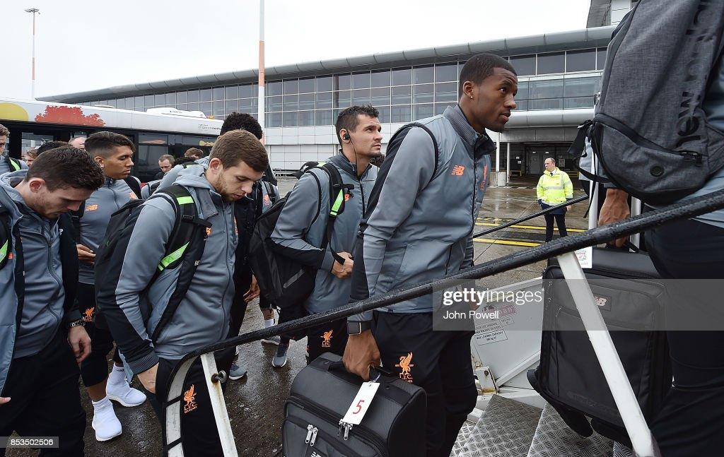 Georginio Wijnaldum, Dejan Lovren and Jon Flanagan of Liverpool boarding the plane at John Lennon Airport on September 25, 2017 in Liverpool, England.