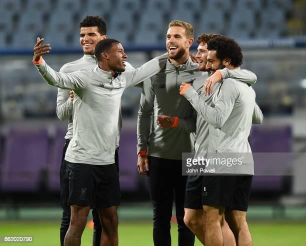 Georginio Wijnaldum Dominic Solanke Jordan Henderson Andrew Robertson and Mohamed Salah of Liverpool during a training session at Stadion Ljudski vrt...