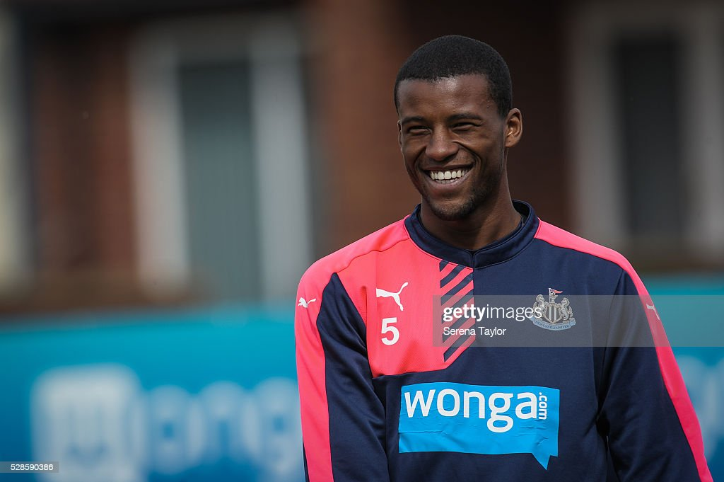 <a gi-track='captionPersonalityLinkClicked' href=/galleries/search?phrase=Georginio+Wijnaldum&family=editorial&specificpeople=2146603 ng-click='$event.stopPropagation()'>Georginio Wijnaldum</a> laughs during the Newcastle United Training session at The Newcastle United Training Centre on May 6, 2016, in Newcastle upon Tyne, England.