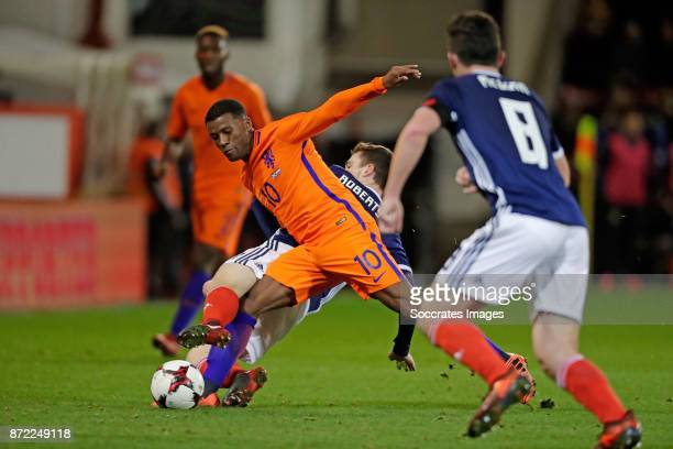 Georginio Wijnaldum of Holland Andy Robertson of Scotland during the International Friendly match between Scotland v Holland at the Pittodrie Stadium...