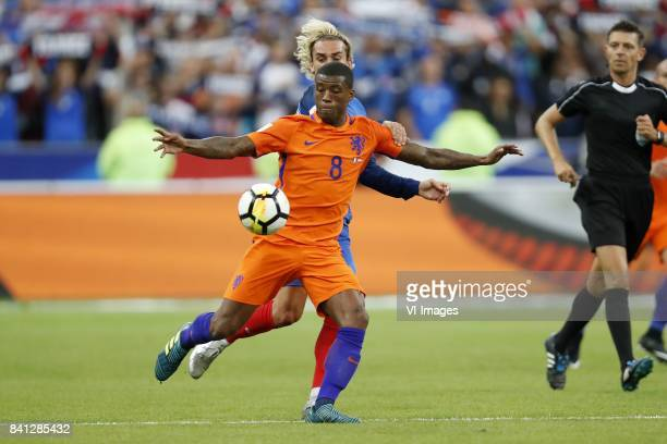 Georginio Wijnaldum of Holland Antoine Griezmann of France referee Gianluca Rocchi during the FIFA World Cup 2018 qualifying match between France and...