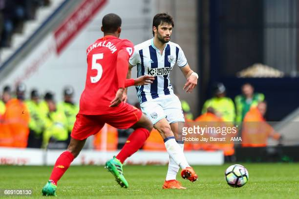 Georginio Wijnaldum of Liverpool and Claudio Jacob of West Bromwich Albion during the Premier League match between West Bromwich Albion and Liverpool...