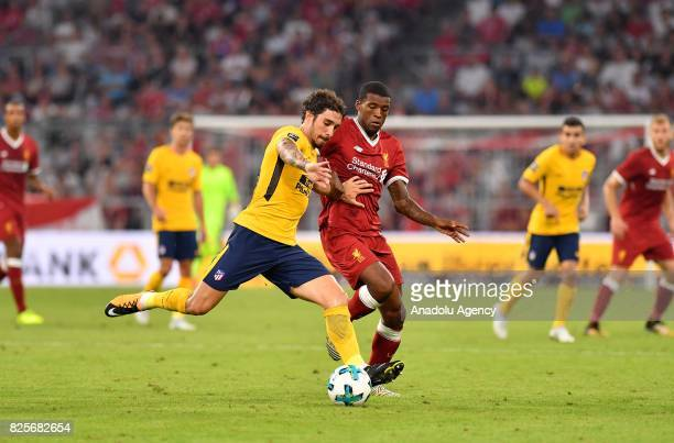 Georginio Wijnaldum of Liverpool and Sime Vrsaljko of Atletico Madrid vie for the ball during the Audi Cup soccer final match between FC Liverpool...