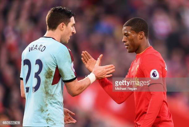 Georginio Wijnaldum of Liverpool and Stephen Ward of Burnley shake hands after the Premier League match between Liverpool and Burnley at Anfield on...