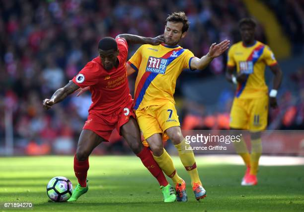 Georginio Wijnaldum of Liverpool and Yohan Cabaye of Crystal Palace compete for the ball during the Premier League match between Liverpool and...