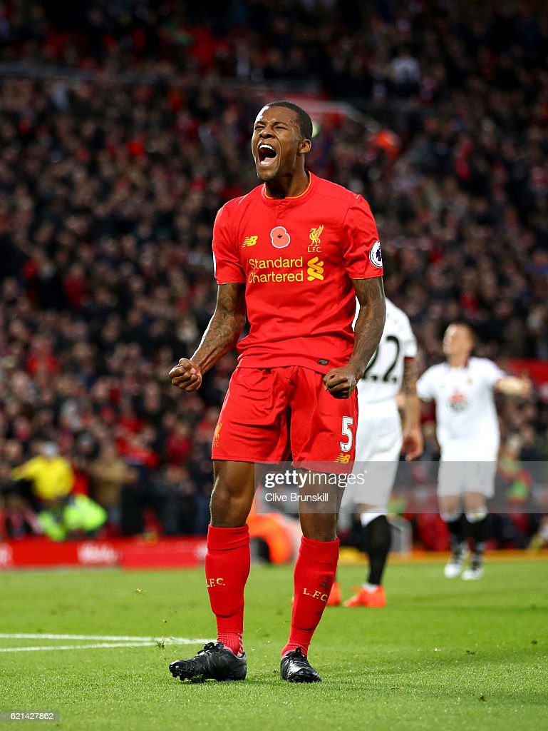 Georginio Wijnaldum of Liverpool celebrates after scoring his sides sixth goal during the Premier League match between Liverpool and Watford at Anfield on November 6, 2016 in Liverpool, England.