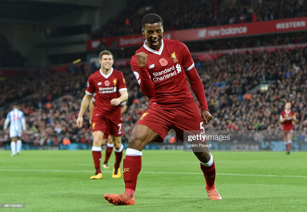 Georginio Wijnaldum of Liverpool celebrates after scoring the third goal during the Premier League match between Liverpool and Huddersfield Town at Anfield on October 28, 2017 in Liverpool, England.
