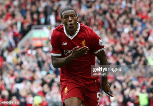 Georginio Wijnaldum of Liverpool celebrates scoring his sides first goal during the Premier League match between Liverpool and Middlesbrough at...