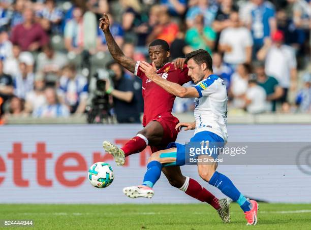 Georginio Wijnaldum of Liverpool FC is challenged by Mathew Leckie of Hertha BSC during the Preseason Friendly match between Hertha BSC and FC...