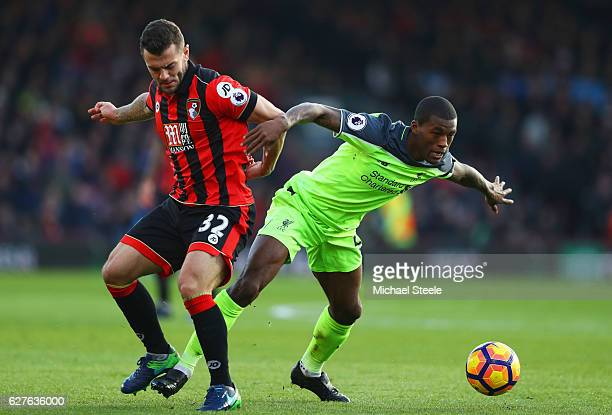 Georginio Wijnaldum of Liverpool holds off Jack Wilshere of AFC Bournemouth during the Premier League match between AFC Bournemouth and Liverpool at...